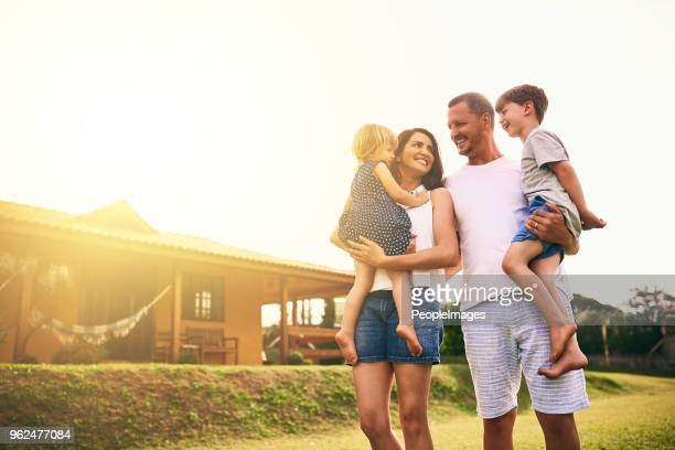 being a family means being part of something very wonderful - family house stock photos and pictures