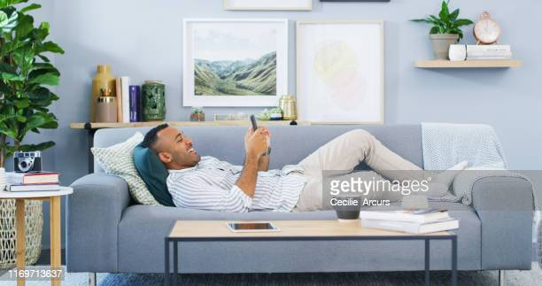 being at home is the best feeling - lying down stock pictures, royalty-free photos & images