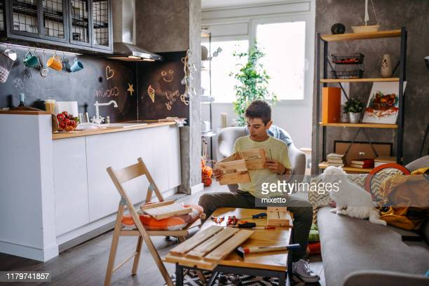 being creative with help of his dog - small apartment stock pictures, royalty-free photos & images