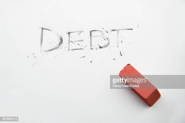 debt being erased - eraser stock pictures, royalty-free photos & images