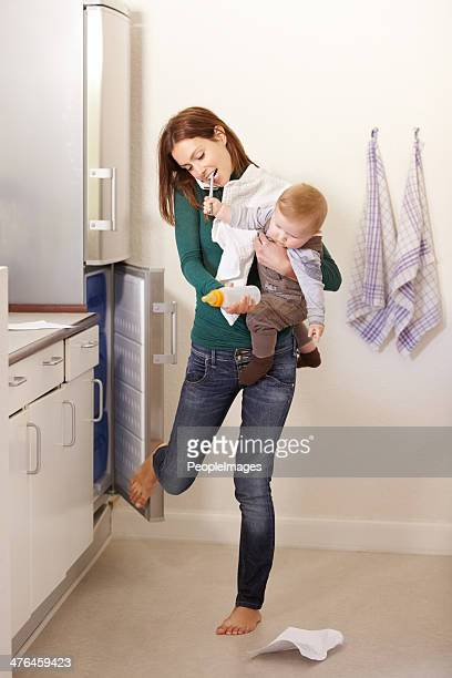 being mom is a balancing act! - multi tasking stock pictures, royalty-free photos & images
