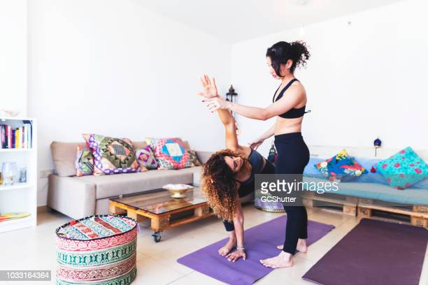 Being strict with a friend as she tries various yoga poses.
