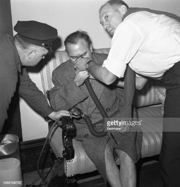 Being treated for smoke poisoning Charles Ross a resident of the Mayflower Hotel inhales oxygen in the hotel lobby Ross was later removed to the...