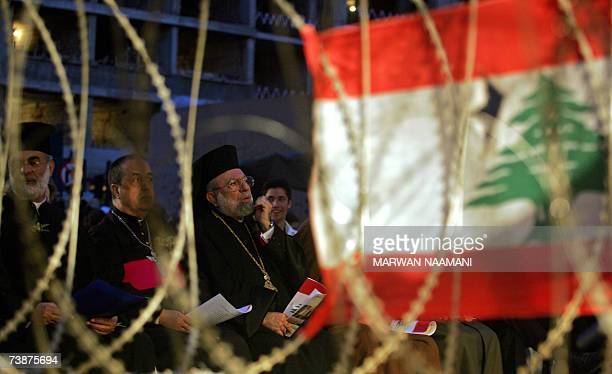 Barbed wire splits Lebanese Christian religious figures from their Muslim and Druze colleagues as they attend a ceremony to mark the 32nd anniversary...