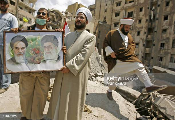 A Lebanese Sunni Muslim cleric holds a picture depicting late founder of Iran's Islamic Revolution Ayatollah Ruhollah Khomeiny and Iran spiritual...