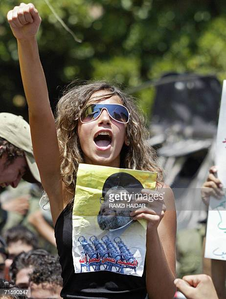A Lebanese woman holds a poster of Hezbollah Secretary General Hassan Nasrallah as she shouts slogans during a protest held outside the Lebanese...