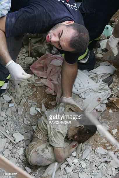 A rescue worker gestures as he removes the dead body of a Lebanese teenager found 08 August 2006 in the rubble of a building hit by an Israeli strike...