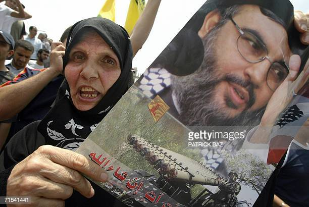 A supporter of Hezbollah holds a poster of the Party of God Secretary General Sheikh Hassan Nasrallah during a protest in Beirut 30 July 2006...