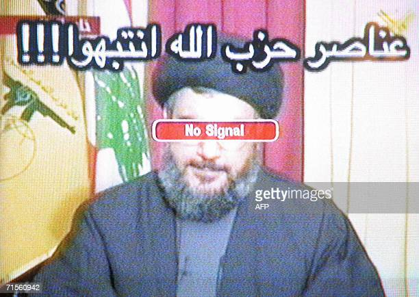 A TV grab taken from Hezbollah's alManar TV shows Hezbollah Secretary General Hassan Nasrallah with a No signal sign covering his eyes and a message...