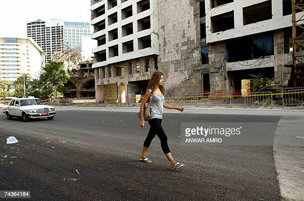 A woman walks 31 May 2007 over what used to be a huge crater at the site where a massive car bomb killed Lebanese prime minister Rafiq Hariri in...