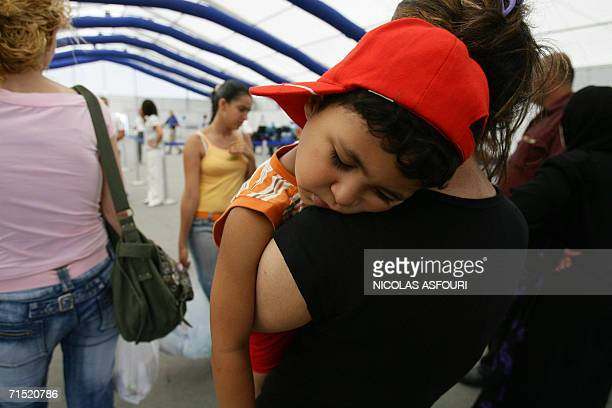 An AmericanLebanese woman holds her sleeping child before boarding the chartered Greek ferry Orient Queen 26 July 2006 to flee Lebanon More than...