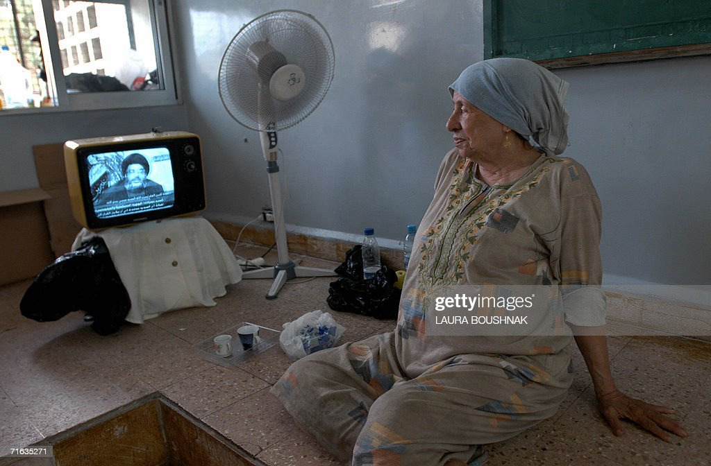 An elderly Lebanese woman watches Hezbol : News Photo
