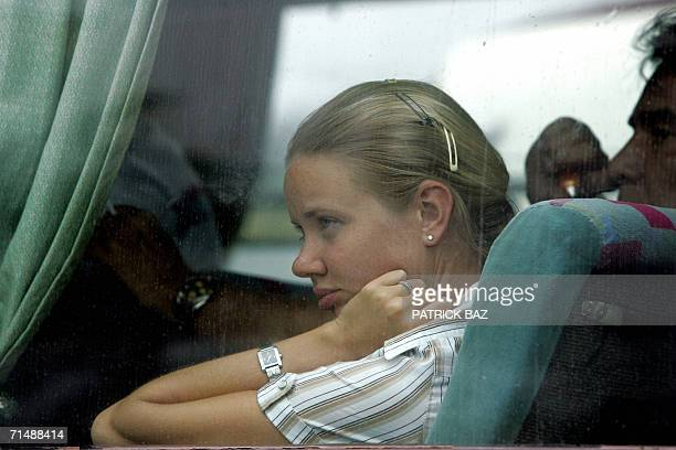An Italian woman is seen inside a bus as she arrives at Beirut's port to be evacuated on a military ship from Lebanon 20 July 2006 Due to the Israeli...