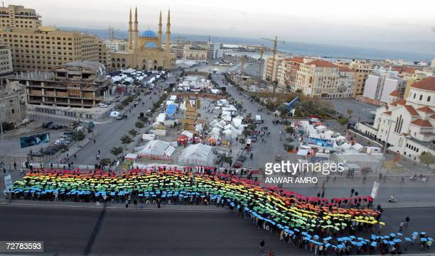 Anti-government protesters carry the colors of the opposition movements as they march near their camps outside the Serail in downtown Beirut 09...