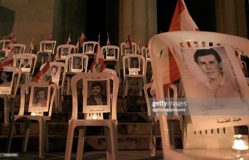 Candles lit the pictures of Lebanese civ... : News Photo