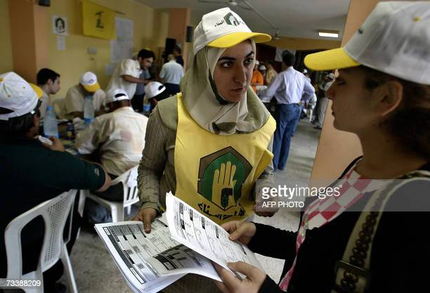 Female engineers of proIranian Hezbollah Jihad alBinaa Department share information of documents detailing areas of destruction in Beirut's southern...