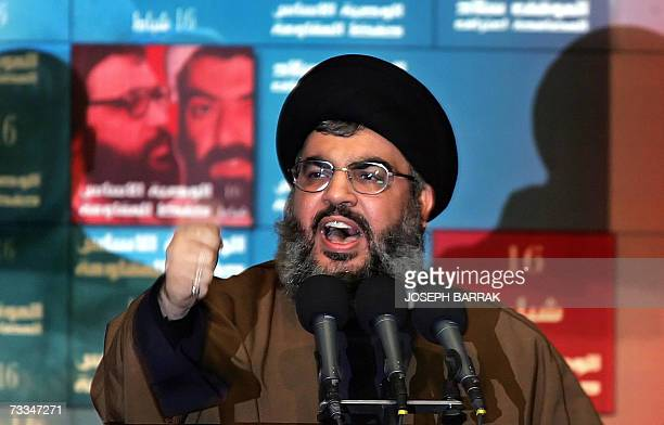 Hezbollah chief Hassan Nasarallah gestures as he delivers a speech during a ceremony to mark the annual commemoration of the killing of two senior...