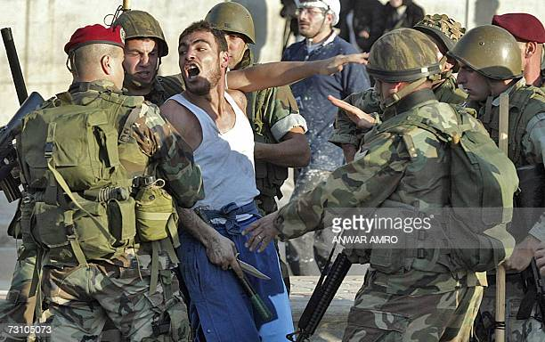 Lebanese army soldiers arrest a Hezbollah supporter brandishing a knife in Beirut 25 January 2007 One person was killed and around 20 injured in...