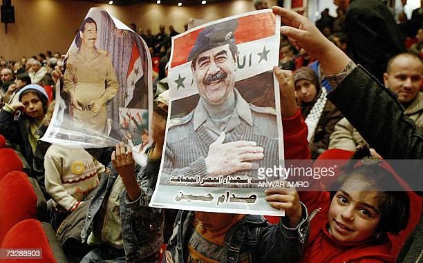 Lebanese children display posters of late Iraqi leader Saddam Hussein during a ceremony in Beirut to mark the 40th day since his execution 11...