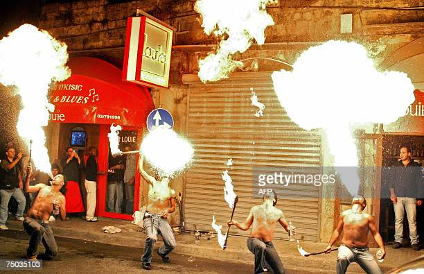 Lebanese fire eaters perform in the Gemmayze area in the heart of Beirut late 04 July 2007 as part of a campaign to revive night life in the...