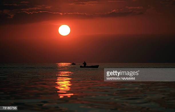 Lebanese fishermen fish at sunset in Beirut sea in a relatively warm weather 02 February 2007 The UN climate panel today blamed humans for global...