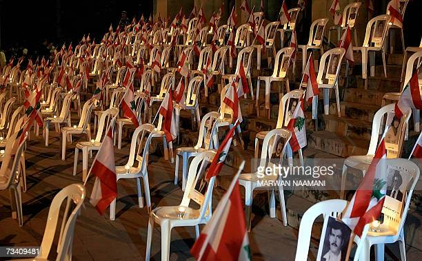 Lebanese flags ad candles decorate pictures of Lebanese civilians who went missing in Lebanon's 19751990 civil war during a ceremony organized by...