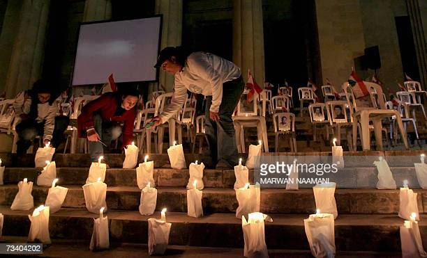 Lebanese light candles during a ceremony organized by Offer Joie Give Joy Non Governmental Organisation 23 February 2007 to honor Lebanese civilians...
