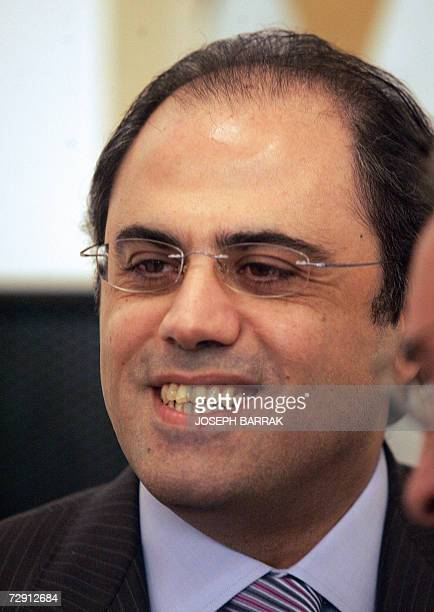 Lebanese Minister of Finance Jihad Azour smiles as he attends a press conference by Lebanese Prime Minister Fuad Siniora at the Grand Serail in...