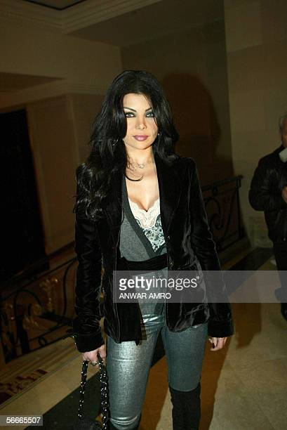 Lebanese pop star Haifa Wehbe poses after receiving the 'Personality of the Year' trophy at an awards ceremony held by Elaph Arabic news website in...