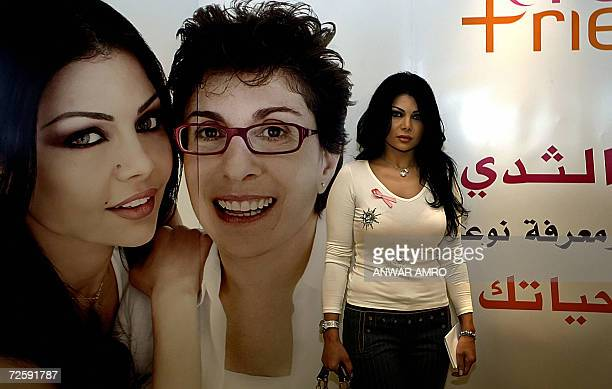 Lebanese singer Haifa Wehbe poses for a picture as she arrives for a press conference to promote a book about Breast Cancer in Beirut 17 November...