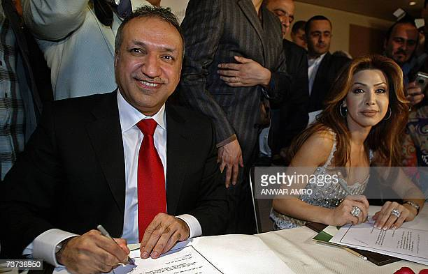 Lebanese singer Nawal alZoghbi signs with Salem alHinidi Middle East Manger of Rotana music company a contract during a a press conference late 28...