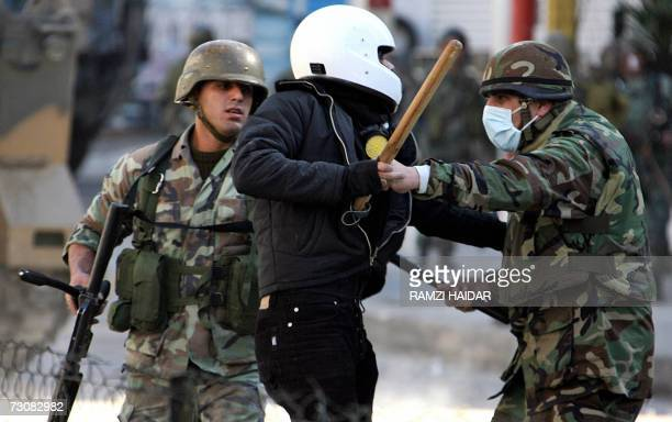 Lebanese soldiers hold back an opposition supporter during clashes with government supporters in Beirut 23 January 2007 Dozens of people were wounded...