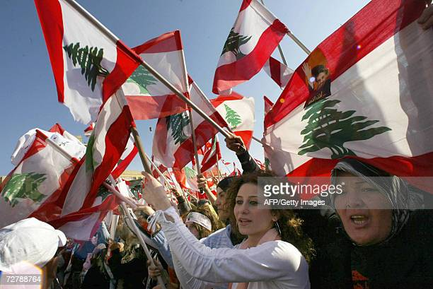 Lebanese wave their national flags on the tenth day of an openended protest to demand the resignation of Lebanese Prime Minister Fuad Siniora in...