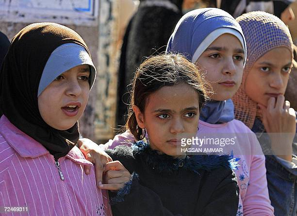 Palestinian girls attend a demonstration held in the refugee camp of Burj alBarajneh in Beirut 09 November 2006 to denounce an Israeli strike that...