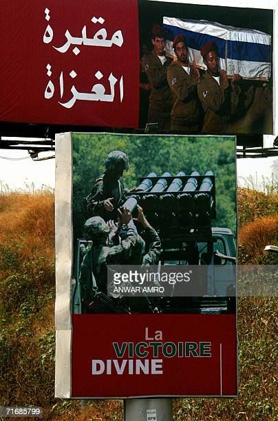 Posters erected by zealots of proIranian Hezbollah along a Beirut highway 21 August 2006 shows an image of fighters loading Katiyusha rockets and a...