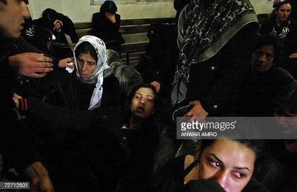 Relatives of 20yearold Shiite Amal movement militant Ahmad Mahmud comfort his sister Zeinab at the alShahidayn morgue in Beirut 04 December 2006...