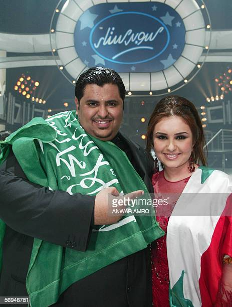 Saudi Arabian singer Ibrahim alHakami holds his national flag after winning over Syrian singer Shahd Barmada the Arab Superstar title in the...