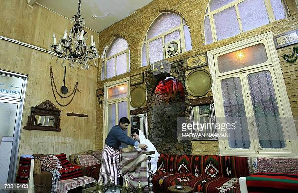 TO GO WITH AFP FEATURE BY MARWAN NAAMANI A clinet relaxing in the saloon of Hamam alNuzha in Beirut 10 February 2007 With just towels wrapped around...
