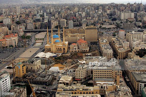 TO GO WITH AFP STORY A general view of downtown Beirut 16 June 2006 a seafront construction site in front of the former Holiday Inn hotel still...
