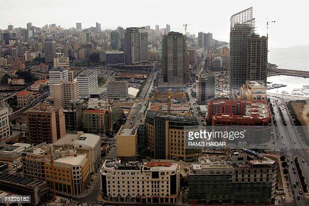 TO GO WITH AFP STORY A general view of downtown Beirut 16 June 2006 shows a seafront construction site in front of the former Holiday Inn hotel still...