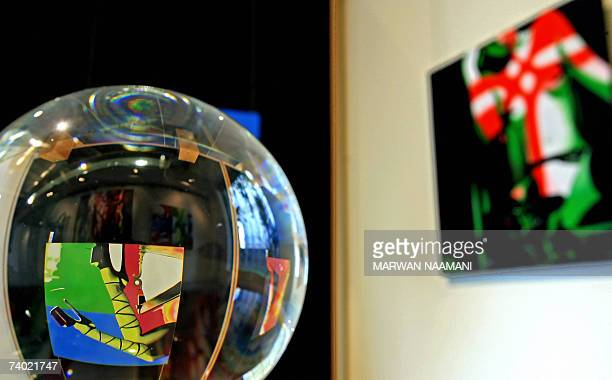 TO GO WITH AFP STORY IN ENGLISH BY SALIM YASSINE A painting entitled Fixation by young Lebanese artist Maria Sarkis is reflected in a glass marble...