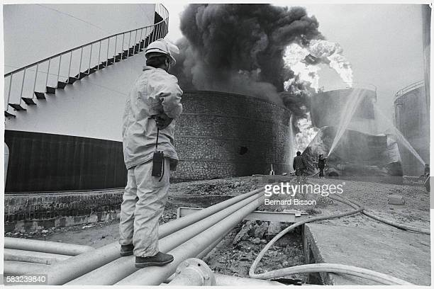 Beirut's main gasoline warehouse burning during combat between Christian factions.