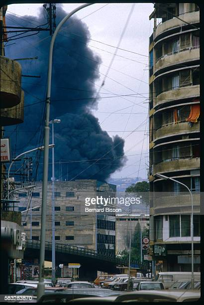 Beirut's main gasoline warehouse burning during combat between Christian factions
