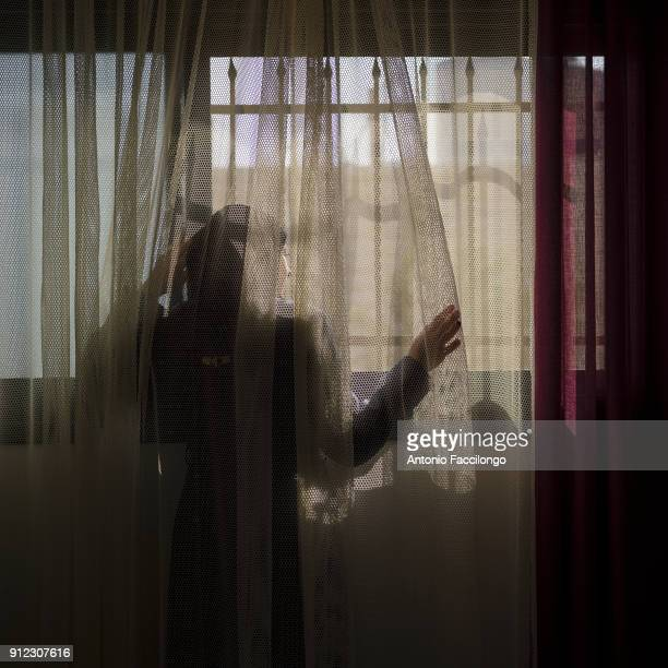 Beit Rima Lydia Rimawi at the window in her house She has a son Majd who was born through IVF Lydia'u2019s husband Abdel Karim has been arrested...