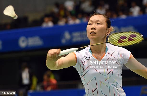 Beiwen Zhang of the US hits a return against Akane Yamaguchi of Japan during their women's singles second round match at the Japan Open Superseries...