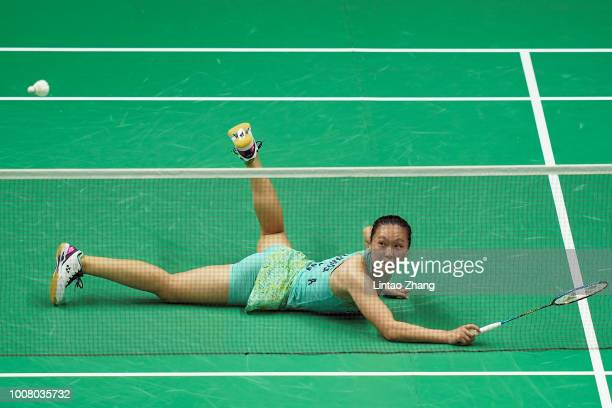 Beiwen Zhang of United States hits a shot against Chloe Birch of England in their women's singles match during the day two of Total BWF World...