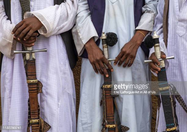 Beja tribe warriors with their swords Red Sea State Port Sudan Sudan on December 31 2018 in Port Sudan Sudan