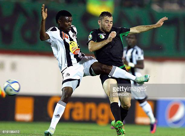 Bejaia's Chongo Kabaso vies with Mazembe's Malek Ferhat during the CAF Confederation cup final Algerian Mouloudia Bejaia against Congolese TP Mazembe...