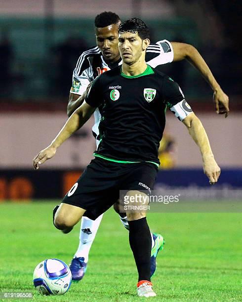 Bejaia's Christian Raoul Kouame Koffi vies with Mazembe's Faouzi Yaya during the CAF Confederation cup final Algerian Mouloudia Bejaia against...