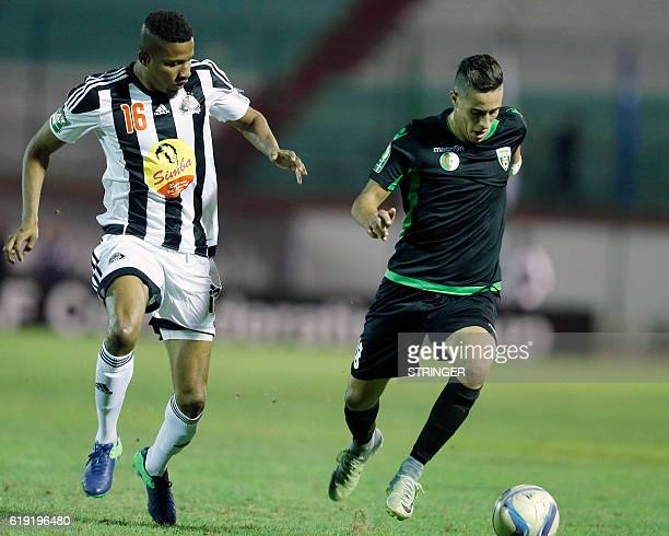 Bejaia's Christian Raoul Kouame Koffi vies with Mazembe's Mohamed Yacine Atmani during the CAF Confederation cup final Algerian Mouloudia Bejaia...